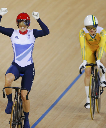 GOLD: Victoria Pendleton celebrates her win as a dejected Meares looks on.