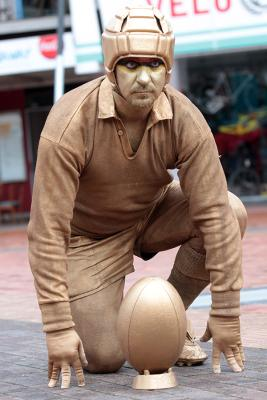 Creaghie Beere, the human statue, gets ready for the kick off.
