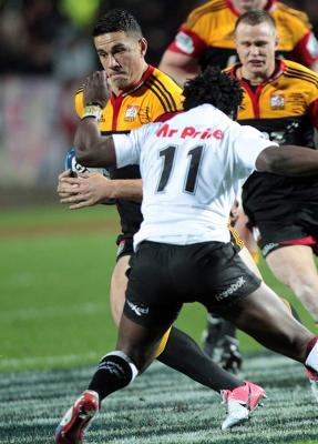 Sonny Bill Williams left dodges Sharks left wing Lwazi Mvovo.