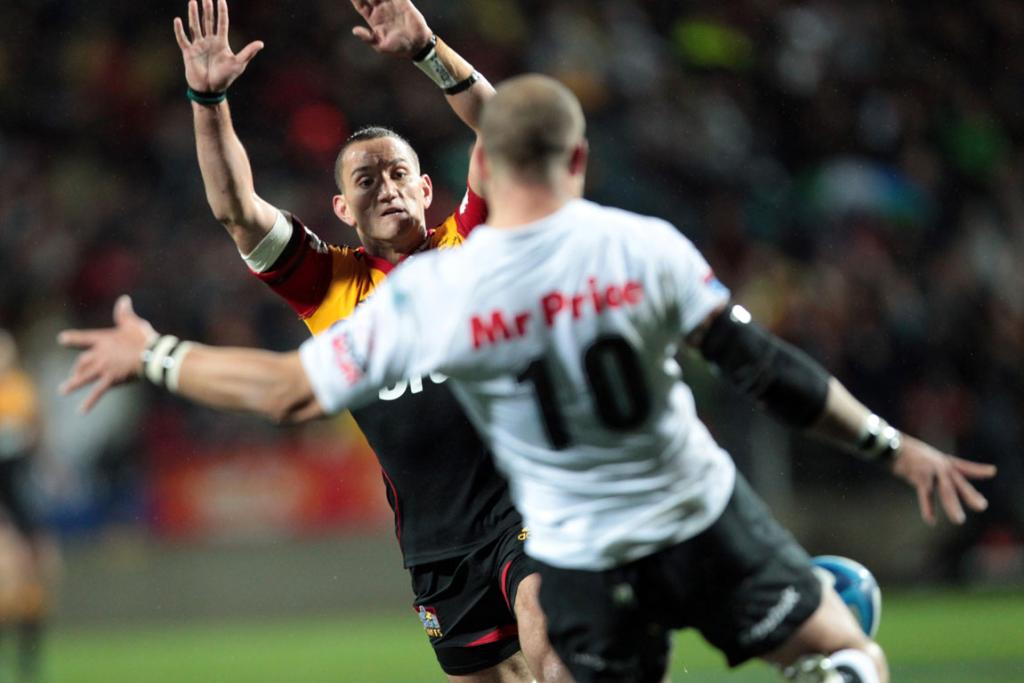 Chiefs first-five Aaron Cruden left comes in to block the kick of  Sharks first-five Frederic Michalak.