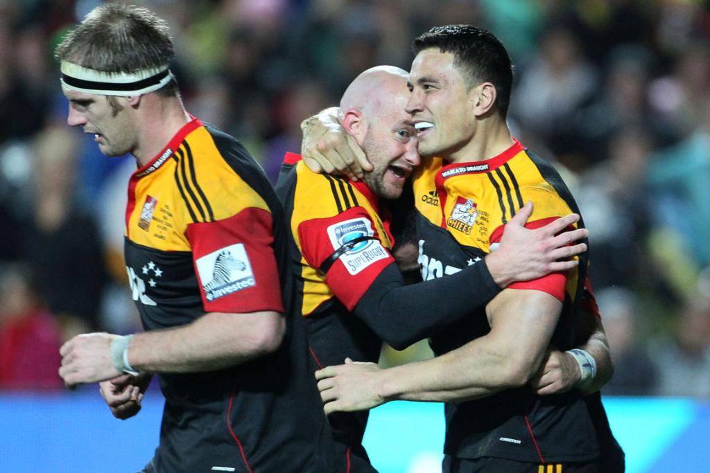 Chiefs lock Craig Clarke, Brendon Leonard and Sonny Bill Williams celebrate after Williams scored a try against the Sharks at Waikato Stadium.