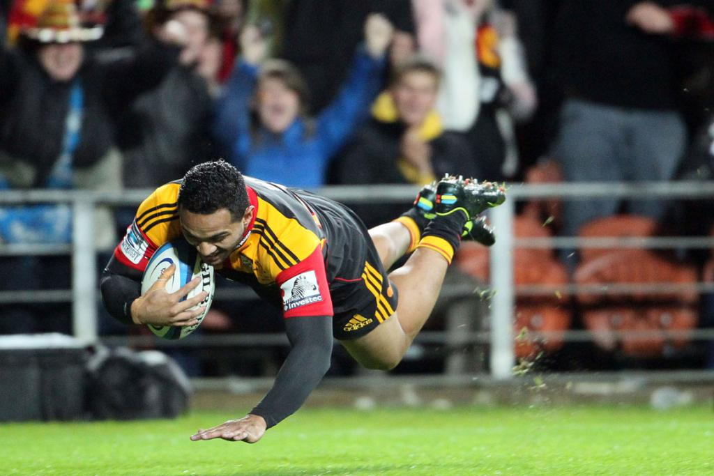 Chiefs' Lelia Masaga dives over to score a try against the Sharks at Waikato Stadium.