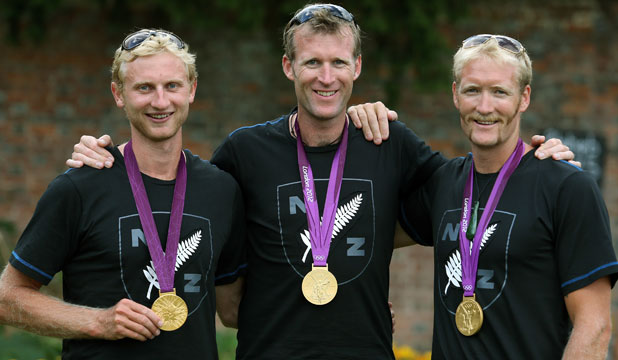 GOLD: Hamish Bond, Mahe Drysdale and Eric Murray celebrate their gold medals.