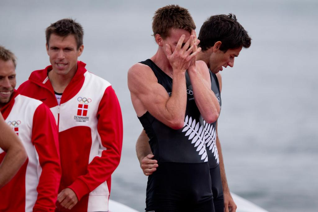 The emotion of claiming bronze is too much for Peter Taylor (left), comforted by team-mate Storm Uru.