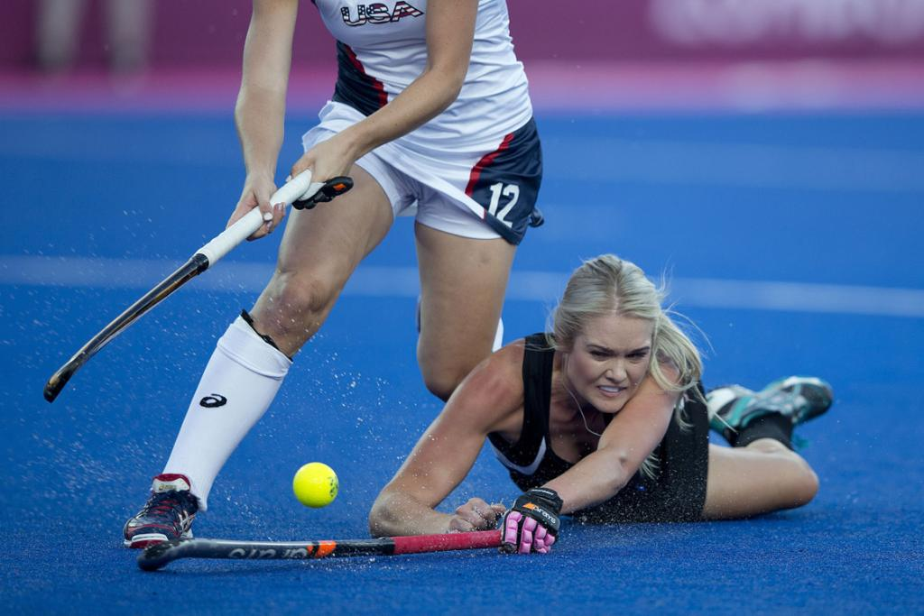 Samantha Harrison dives for a ball during the game against the USA.