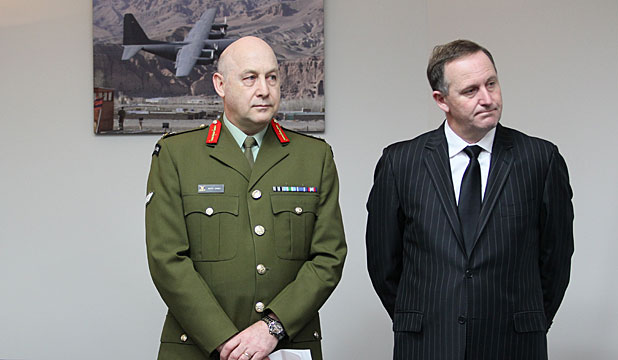 SAD DAY: Chief of Defence Force Lieutenant General Rhys Jones and Prime Minister John Key at Whenuapai Air Base.