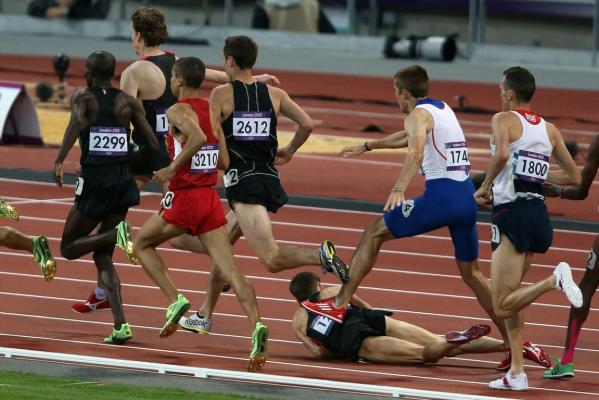 New Zealand's Nick Willis (2612) narrowly misses the fall of Nathan Brannan during the a men's 1500m semifinal at the 2012 London Olympic Games.