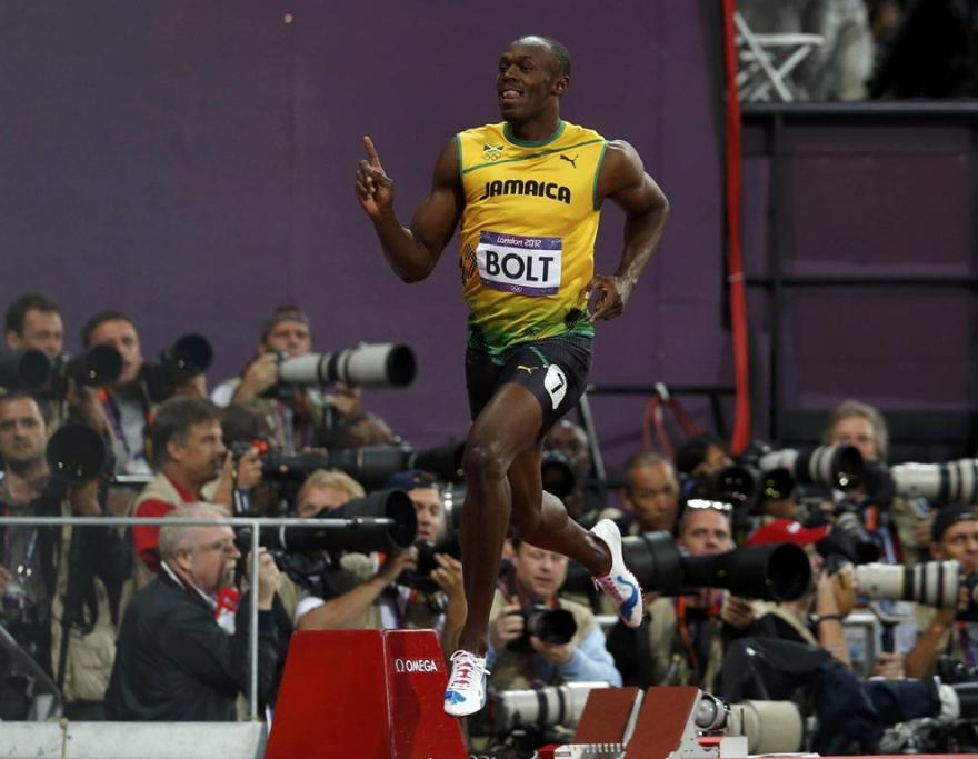 Jamaica's Usain Bolt celebrates after winning the men's 100m final during the London 2012 Olympic Games.