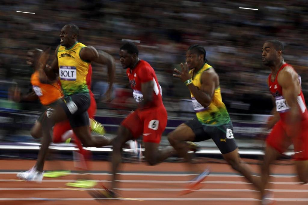 Jamaica's Usain Bolt (second from left) sprints ahead of the field to win the men's 100m final during the London 2012 Olympic Game