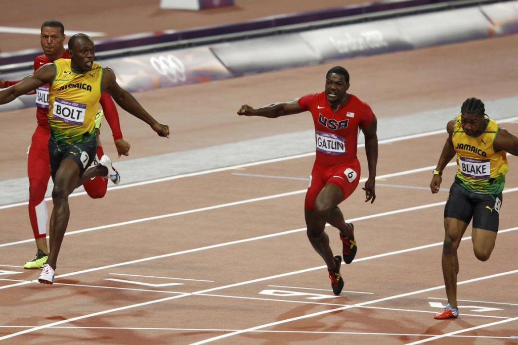 From left, Jamaica's Usain Bolt, Justin Gatlin of the US and Jamaica's Yohan Blake cross the finish line in the men's 100m final during the London 2012 Olympic Games at the Olympic Stadium.