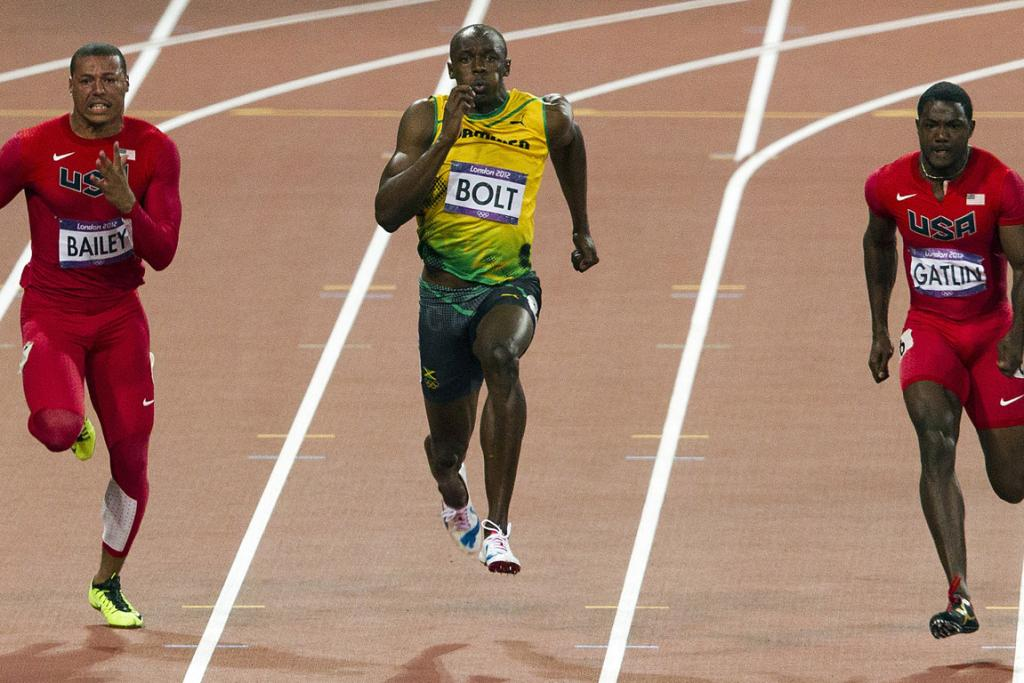 Usain Bolt is flanked by Americans Ryan Bailey and Justin Gatlin in the 100m final.