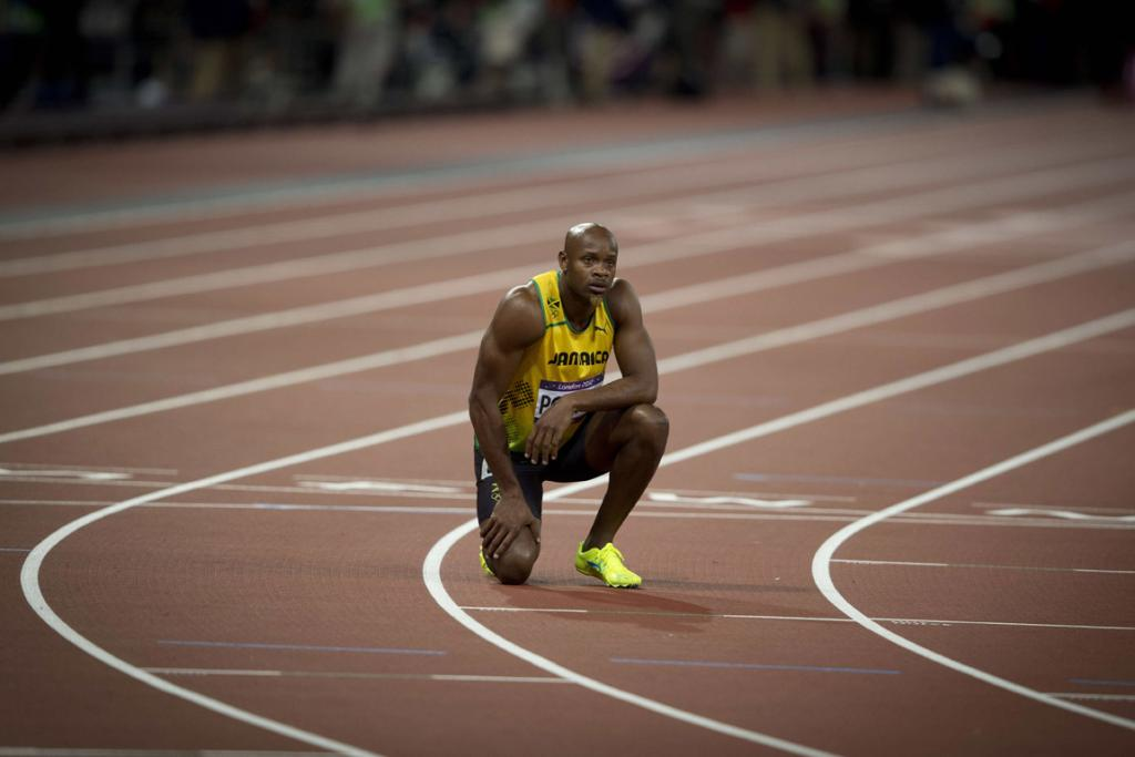 Asafa Powell reflects after finishing last in the 100m final.