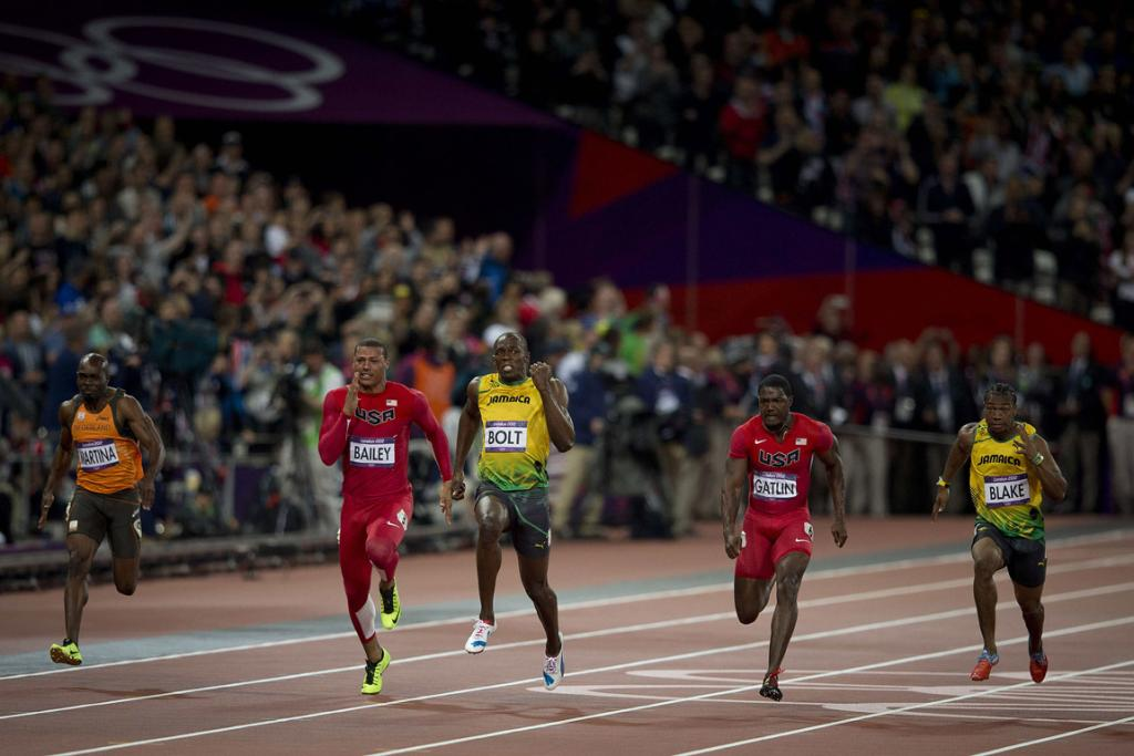 Usain Bolt crosses the line first in the 100m final.