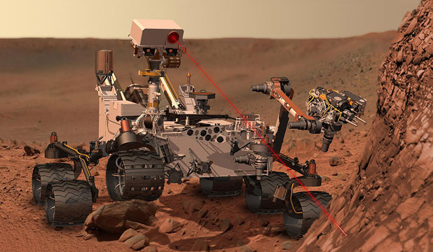 HI-TECH EXPLORER: This artist's concept depicts the rover Curiosity, of Nasa's Mars Science Laboratory mission, as it uses its Chemistry and Camera instrument to investigate the composition of a rock surface.