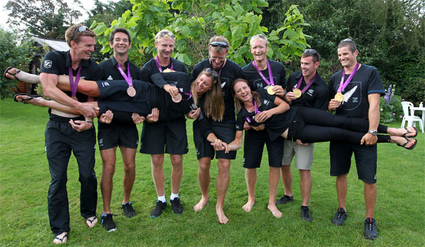 New Zealand's rowing medalists show off the hardware they gathered during the London Olympics regatta. (From left) Peter Taylor, Storm Uru, Hamish Bond, Mahe Drysdale, Eric Murray, Joseph Sullivan, Nathan Cohen, (being held) Rebecca Scown and Juliette Haigh.