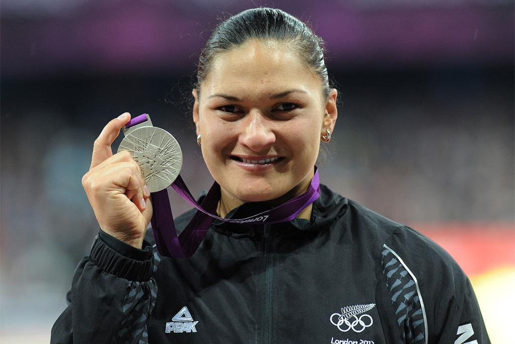 Valerie Adams smiles with her silver Olympic medal in London.
