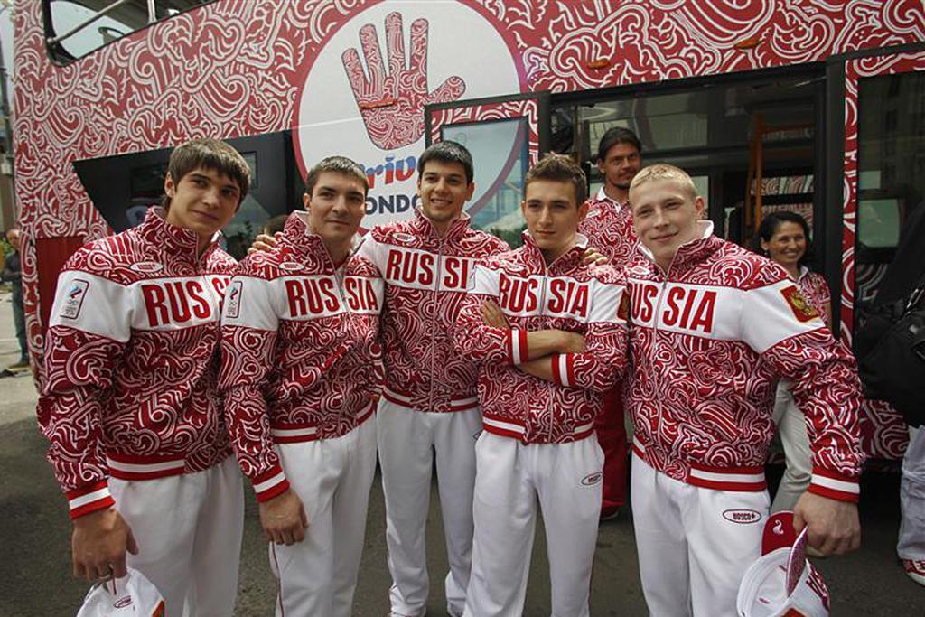 Russian Olympic athletes pose in their track suits in Moscow