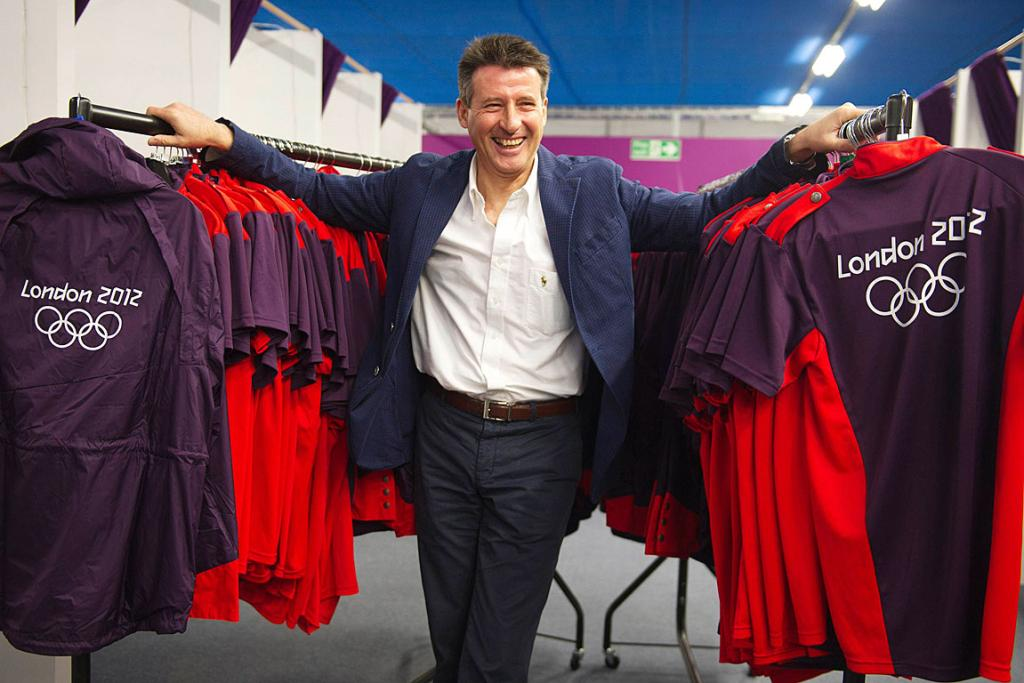 Olympic organising boss, Sebastian Coe, poses for a photograph with some of the London 2012 Olympic Games Time uniforms