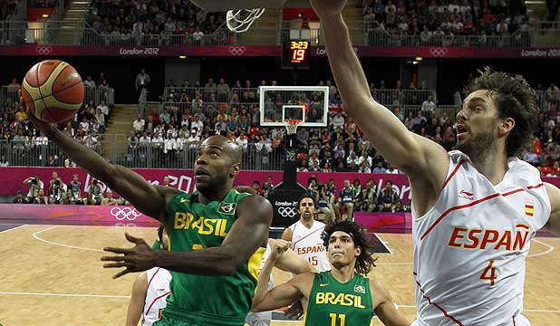 Larry Taylor of Brazil gets past Pau Gasol of Spain during thir men's basketball preliminary round match at the London 2012 Olympic Games.