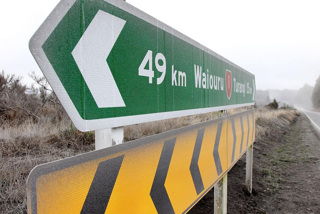 Road signs and the surrounding area are coated in ash on SH1 one after Mt Tongariro erupted for the first time in over 100 years.