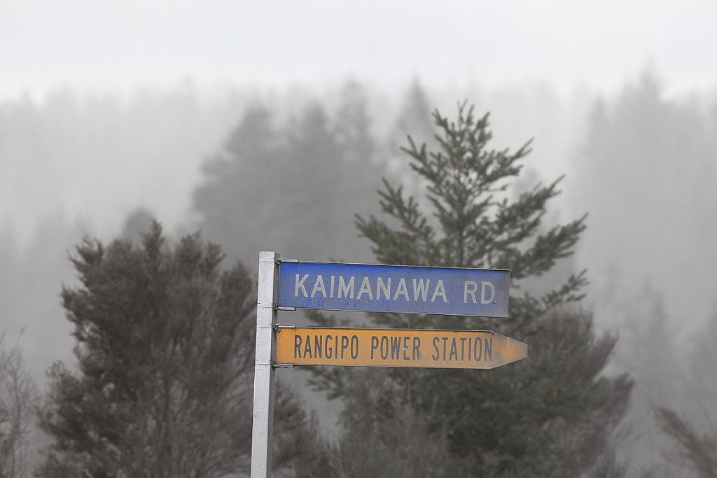 Road signs are coated in ash on state highway one after Mt Tongariro erupted for the first time in over 100 years.
