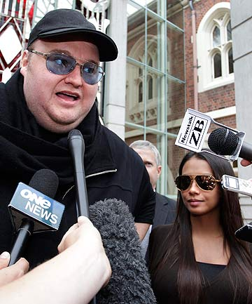 DAY IN COURT: Kim Dotcom stands next to his wife Mona as he talks to members of the media after he left the High Court in Auckland.