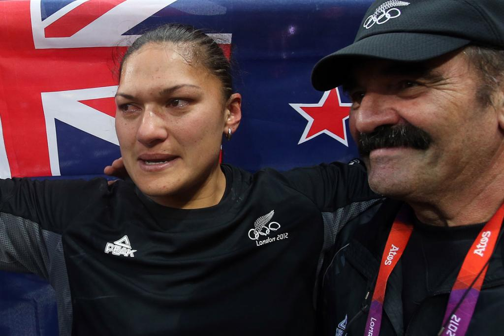 Valerie Adams with her coach Jean-Pierre Egger after the shot put at the London Olympics.