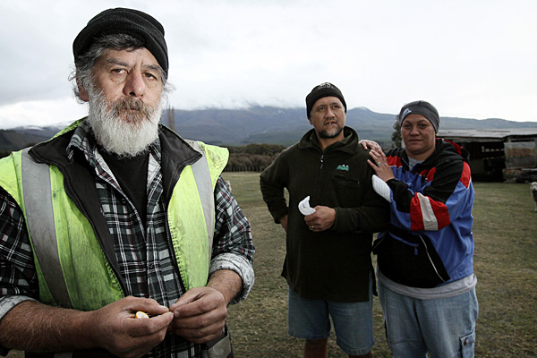 Local residents, Tui, centre, and Joy Campbell, right, who lives at the foot of the mountain returned to check on their animals with Vic Cassin, left.