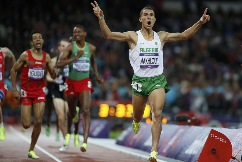 New Zealand's Nick Willis is well back down the track in the final of the men's 1500 metres at the London Olympics as Algeria's Taoufik Makhloufi celebrates his victory.