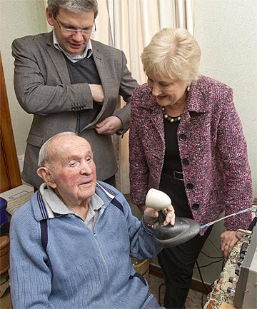 HAPPY AT HOME: MPs Annette King and Iain Lees-Galloway visit 96-year-old Jack Shortt, a long-time resident of Savage Cres.