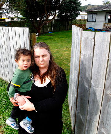 ASTHMA FEARS: Mother and educator Bianca Beach, of Spackman Cres, Paraparaumu, with a client's child, Dallas, 18 months, at her back gate, which opens to where the proposed expressway will run.