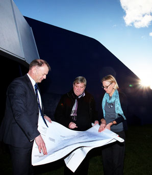 DRAMATIC PLAN: From left, Palmerston North Mayor Jono Naylor, Globe Theatre Trust Board chairman Stephen Fisher and project programmer Katherine Stannard check plans for the rebuild.