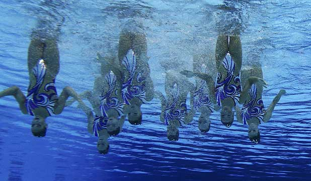 Britain's team are seen underwater as they perform in the synchronised swimming teams technical routine competition at the London 2012 Olympic Games.