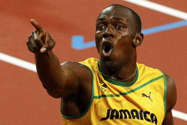 Jamaica's Usain Bolt celebrates after winning the men's 200m final at the London Olympics to complete back-to-back sprint doubles.