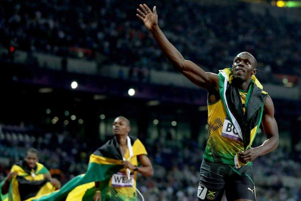 Jamaica's Usain Bolt waves to the crowd after winning the men's 200m final at the London 2012 Olympic Games.