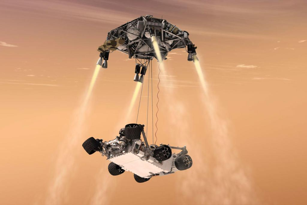 An artist's concept shows the sky crane manoeuvre during the descent of Nasa's Curiosity rover to the Martian surface.