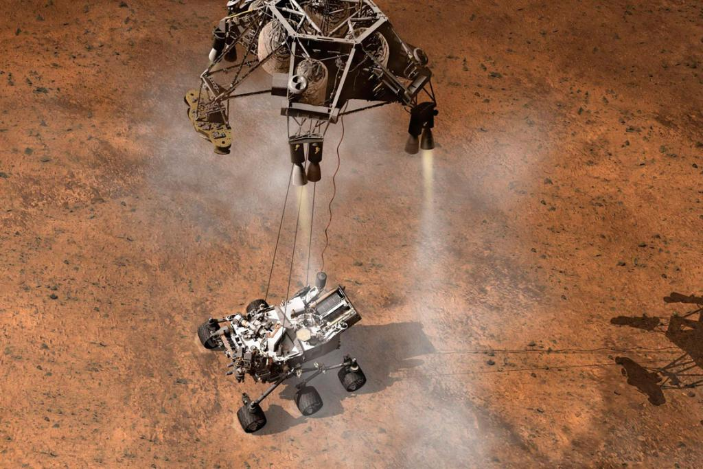 An atist's concept depicts the moment that Nasa's Curiosity rover touches down onto the Martian surface.