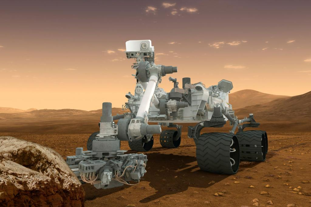An artist's concept features of Nasa's Mars Science Laboratory Curiosity rover on the surface of Mars.