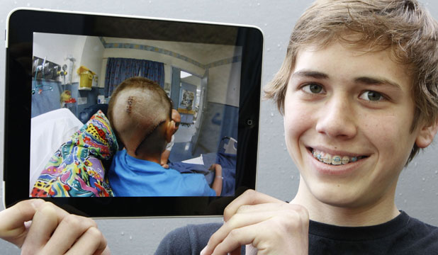 MOTIVATION: Miller Macarthy with a picture of himself after brain surgery.