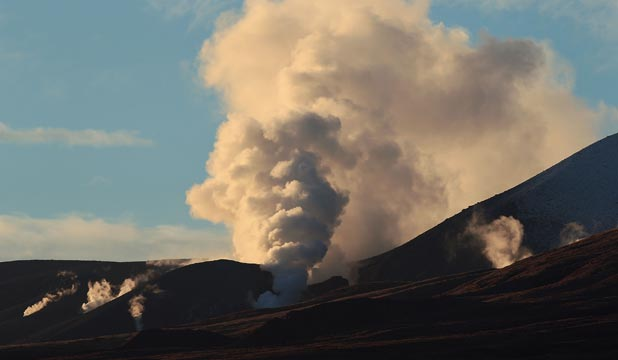 WHAT LIES BENEATH: Tongariro steams following Tuesday's eruption.