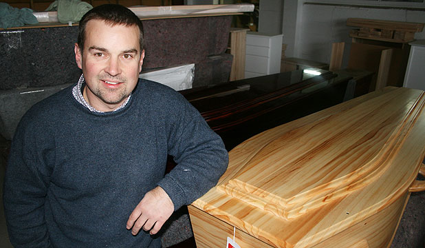 GROWTH BUSINESS: Dean Taylor, of Masterton's Taylormade Furniture, with a solid pine casket the company has developed. ''We're very encouraged by the response we get from funeral directors, and they're obviously getting a good response from their customers,'' he says.