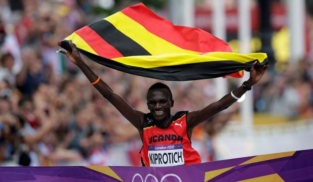 LEADING THE WAY: Ugandan Stephen Kiprotich breaks the tape on The Mall to win the men's marathon.