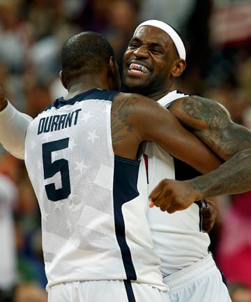 GOLDEN GRAB: Kevin Durant, who led all scorers with 30 points, embraces LeBron James after the USA's 107-100 gold medal win over Spain.