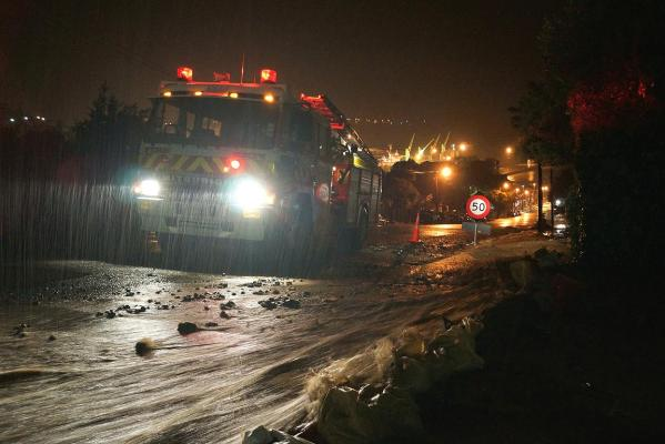 Torrential rain burst a retaining wall which sent water gushing down a main street in Lyttelton.