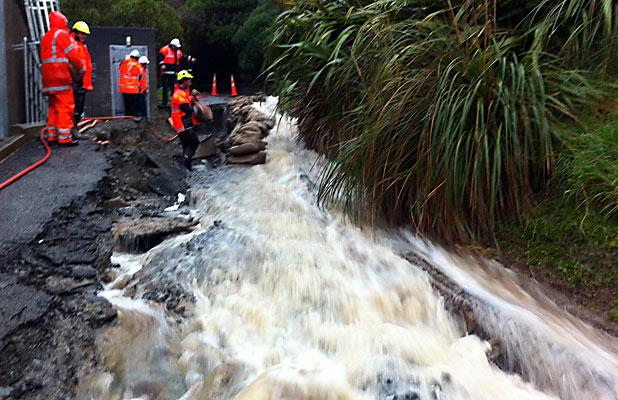 FORCE OF NATURE: River gushes through Canterbury St, Lyttelton.