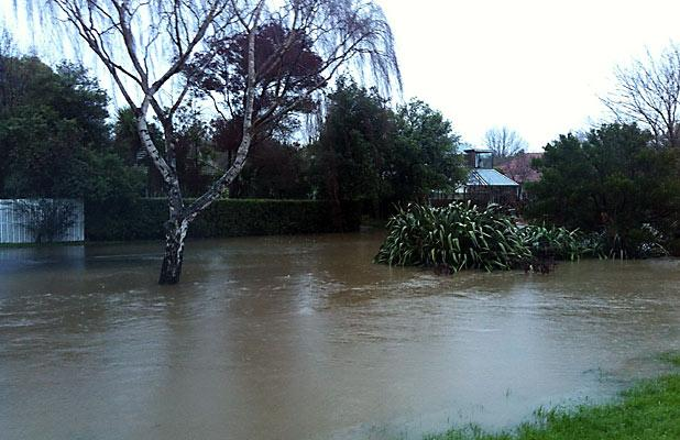 OVERFLOWING: The Heathcote River is spilling onto streets in Beckenham.