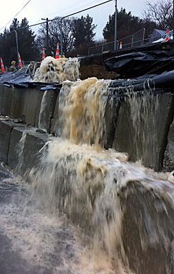 FAILING: A retaining wall in Canterbury St, Lyttelton, is unable to hold back the water.
