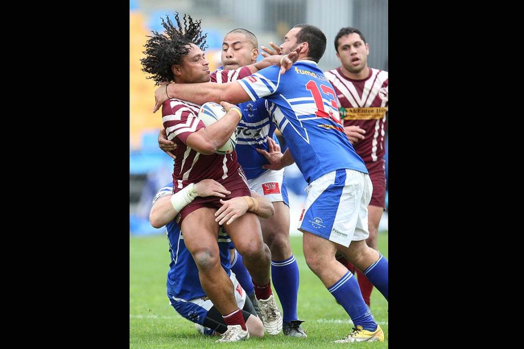 Papakua second rower Solomone Foketi is tackled by Glenora second rower Chris Brown, Glenora replacement Junior Fotu & Glenora lock Issac Ratzlaff in the Glenora Bears & Papakura Sea Eagles Fox Memorial Preliminary Final club rugby league match at Mount Smart Stadium on Saturday afternoon.