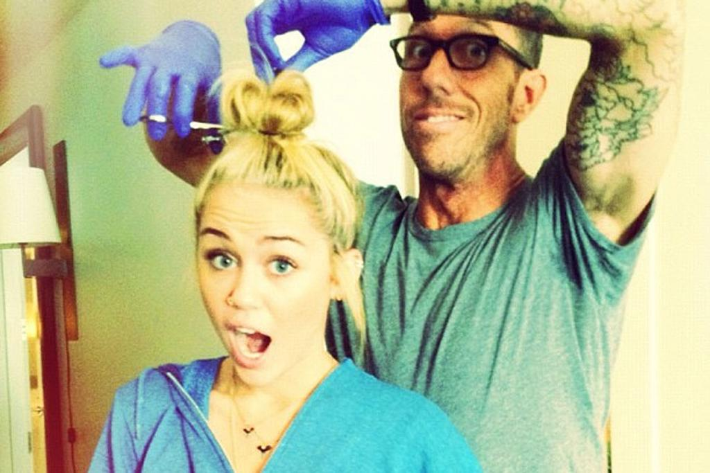 Miley Cyrus gets ready for the chop with hairdresser Chris McMillan.