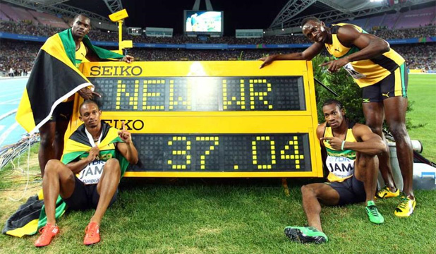 TARGETS:  Nesta Carter, Michael Frater, Yohan Blake and Usain Bolt of Jamaica celebrate victory and a new world record in the men's 4x100 metres relay final.